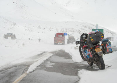 Snow and stuck trucks awaited us just before the Chinese country gate