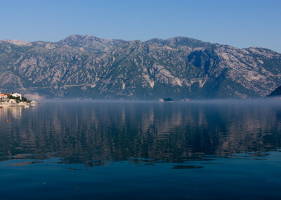 Morning fog rises in the Bay of Kotor