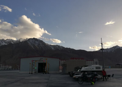 Sunset over the customs parking lot in Tashkurgan