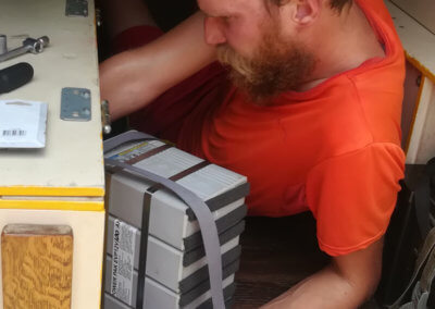 Heiner putting in the new battery for our expedition vehicle electrics